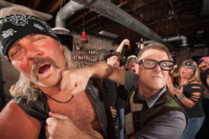Men fighting in a bar - Anyone can be involved in a bar fight leading to assault charges.