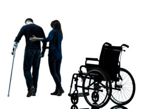 injured man with crutches with woman walking away from wheelchair