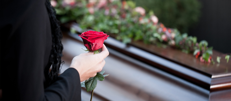 Funeral red rose - Wrongful death lawsuit - Personal injury lawyers in Whitby.