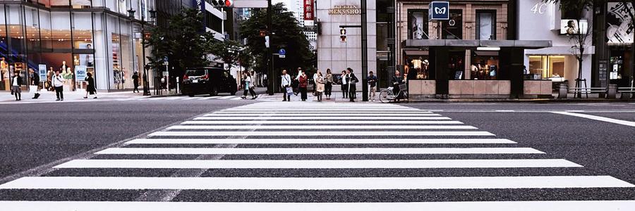 Pedestrian cross walk in a busy city.