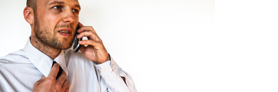 Man frustrated on the phone after coping with brain injury.