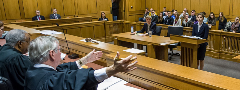 Judge and attorneys practicing tort law in courtroom