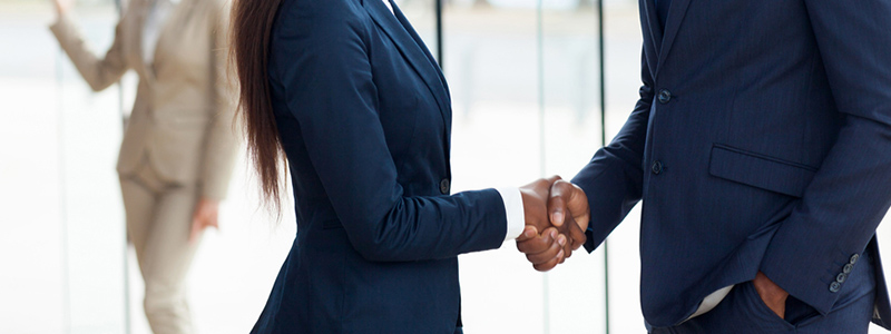 Shaking hands and hiring a lawyer to handle your LTD claim